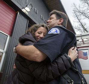 Sue Nixon hugs Les Davis, who was one of the paramedics who came to her aid six years ago after she had a heart attack while she was driving to work.
