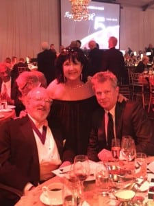 From left to right: longtime museum supporter, Bruce McCaw, columnist for the Puget Sound Business Journal, Patti Payne and David Foster